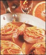 French cuisine pork with orange sauce